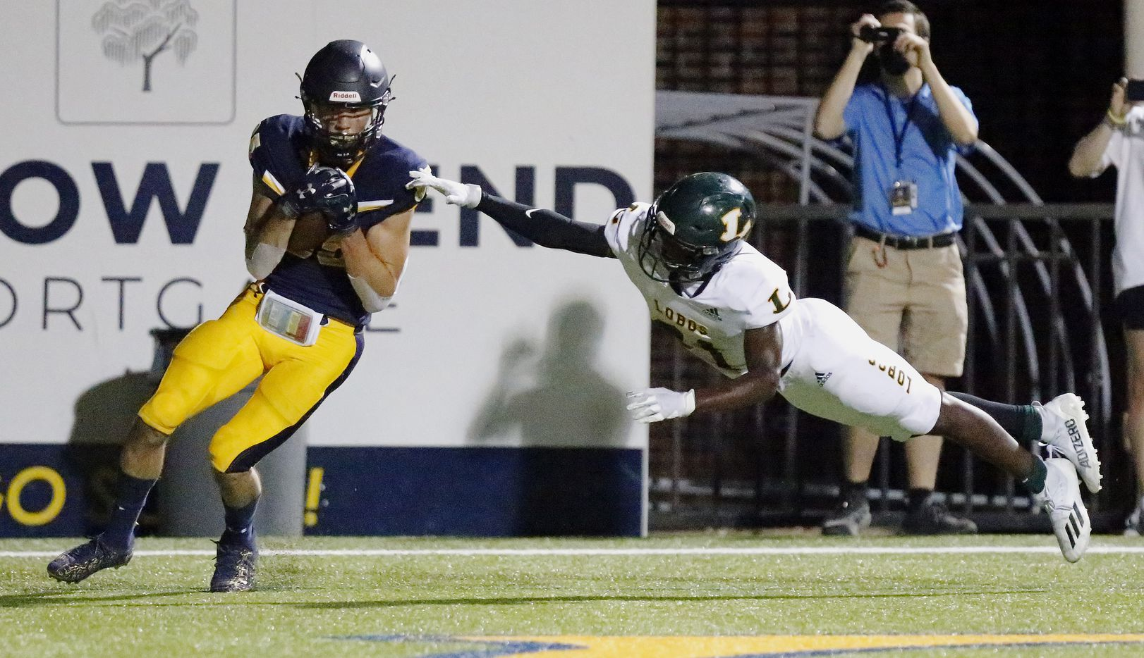 Highland Park High School wide receiver Jackson Heis (85) catches a touchdown pass behind Longview High School defensive back Chase Smith (21) during the second half as Highland Park High School hosted Longview High School at Highlander Stadium in Dallas on Friday night, October 8, 2021. (Stewart F. House/Special Contributor)