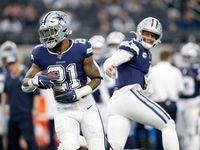 Dallas Cowboys quarterback Dak Prescott (4) hands the ball off to running back Ezekiel Elliott (21) throws during pregame warmups before facing the Los Angeles Rams at AT&T Stadium in Arlington, Texas, Sunday, December 15, 2019.
