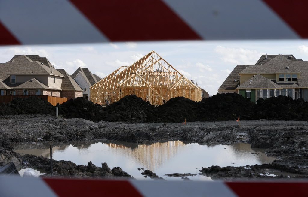 Construction continues in the Light Farms development in Celina, on Friday, September 4, 2015. (Vernon Bryant/The Dallas Morning News)