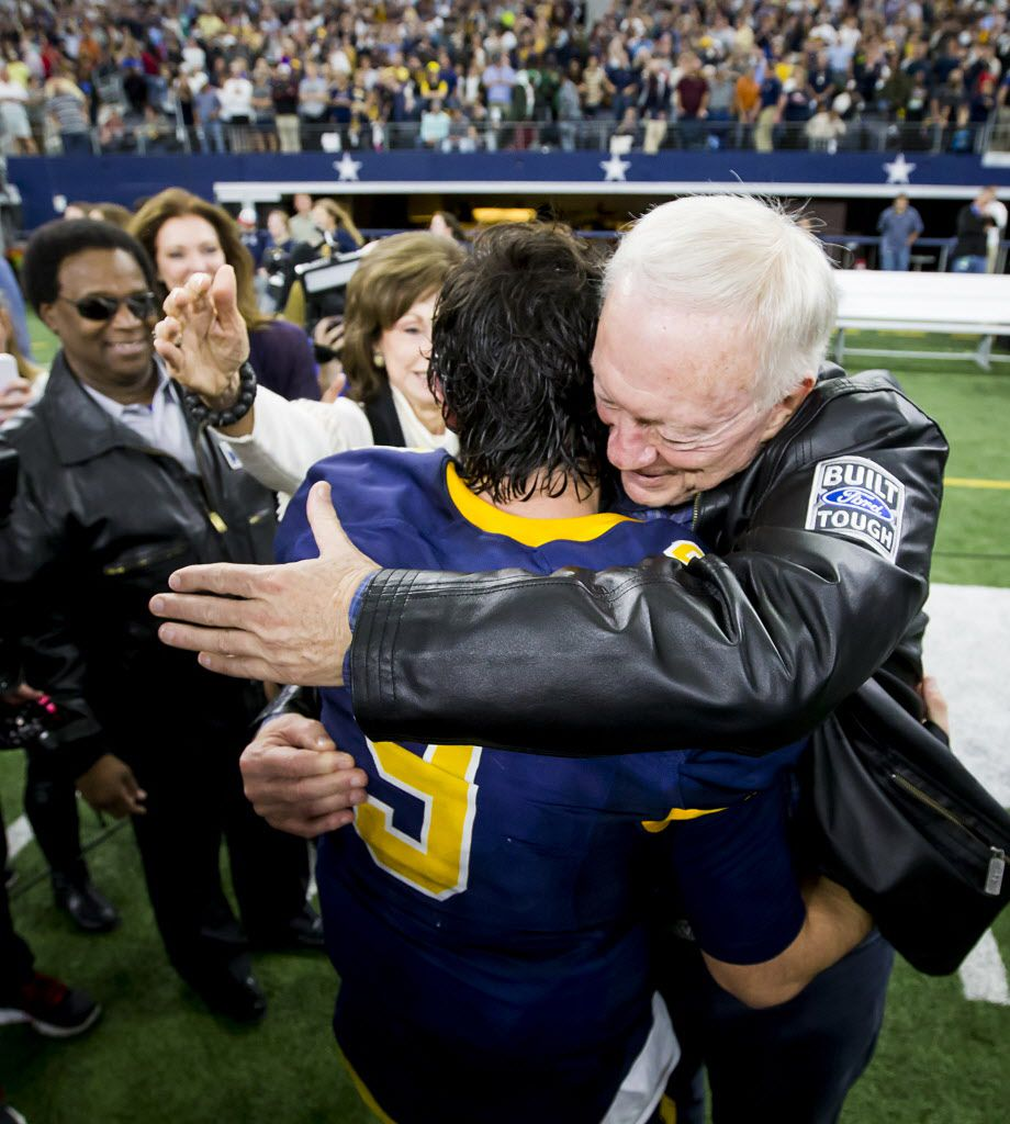 Highland Park quarterback John Stephen Jones (9) gets a hug from his grandfather, Dallas Cowboys owner Jerry Jones, after the Scots' victory over Temple in the UIL Class 5A Division I state football championship football game at AT&T Stadium on Saturday, Dec. 17, 2016, in Arlington.  Highland Park won the game 16-7. (Smiley N. Pool/The Dallas Morning News)