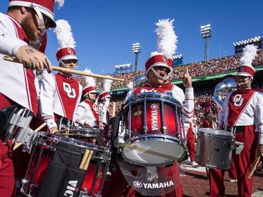 Oklahoma band members get pumped up before an NCAA football game against Texas at the Cotton Bowl on Saturday, Oct. 12, 2019, in Dallas.