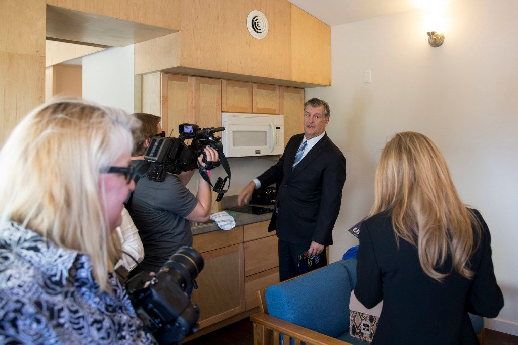Dallas Mayor Mike Rawlings tours the interiors of the finished housing units during the opening ceremony at Cottages at Hickory Crossing on Sept. 8, 2016 in Dallas. The 50 small housing units built by CitySquare opens after more than a year of delays. These housing units are for housing the most expensive chronically homeless people in Dallas.