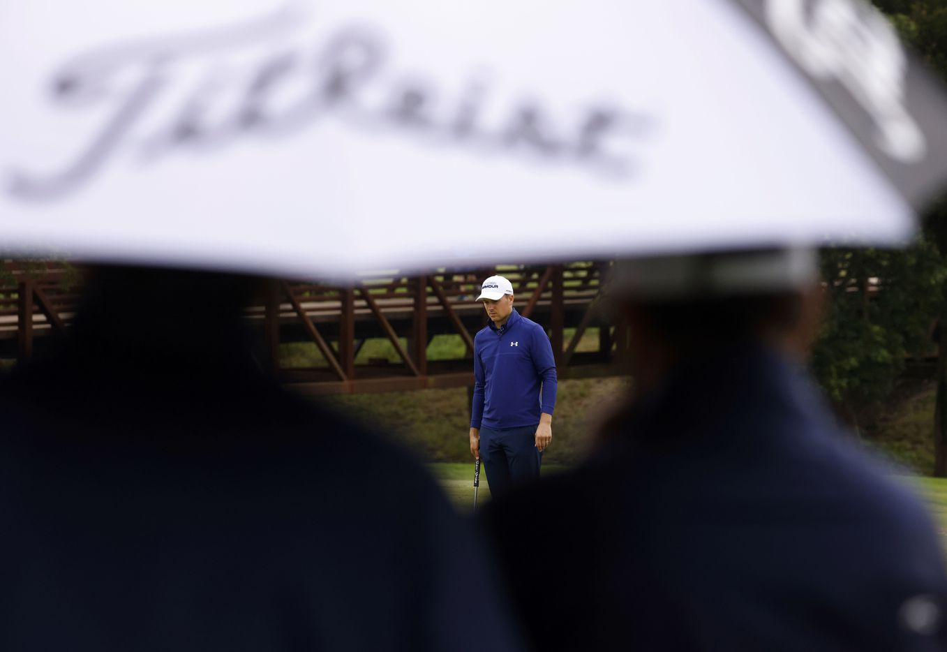 Jordan Spieth looks over the green on the 4th hole as the rain starts during round 4 of the AT&T Byron Nelson  at TPC Craig Ranch on Saturday, May 16, 2021 in McKinney, Texas. (Vernon Bryant/The Dallas Morning News)