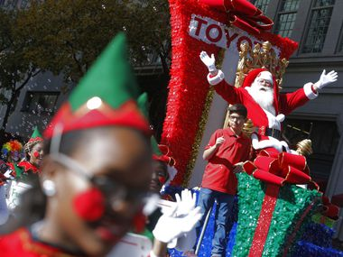 Santa Claus greets the people during the Dallas Holiday Parade in this 2018 file photo. Richardson is among the North Teas cities forced to cancel traditional holiday events this year because of the coronavirus pandemic.