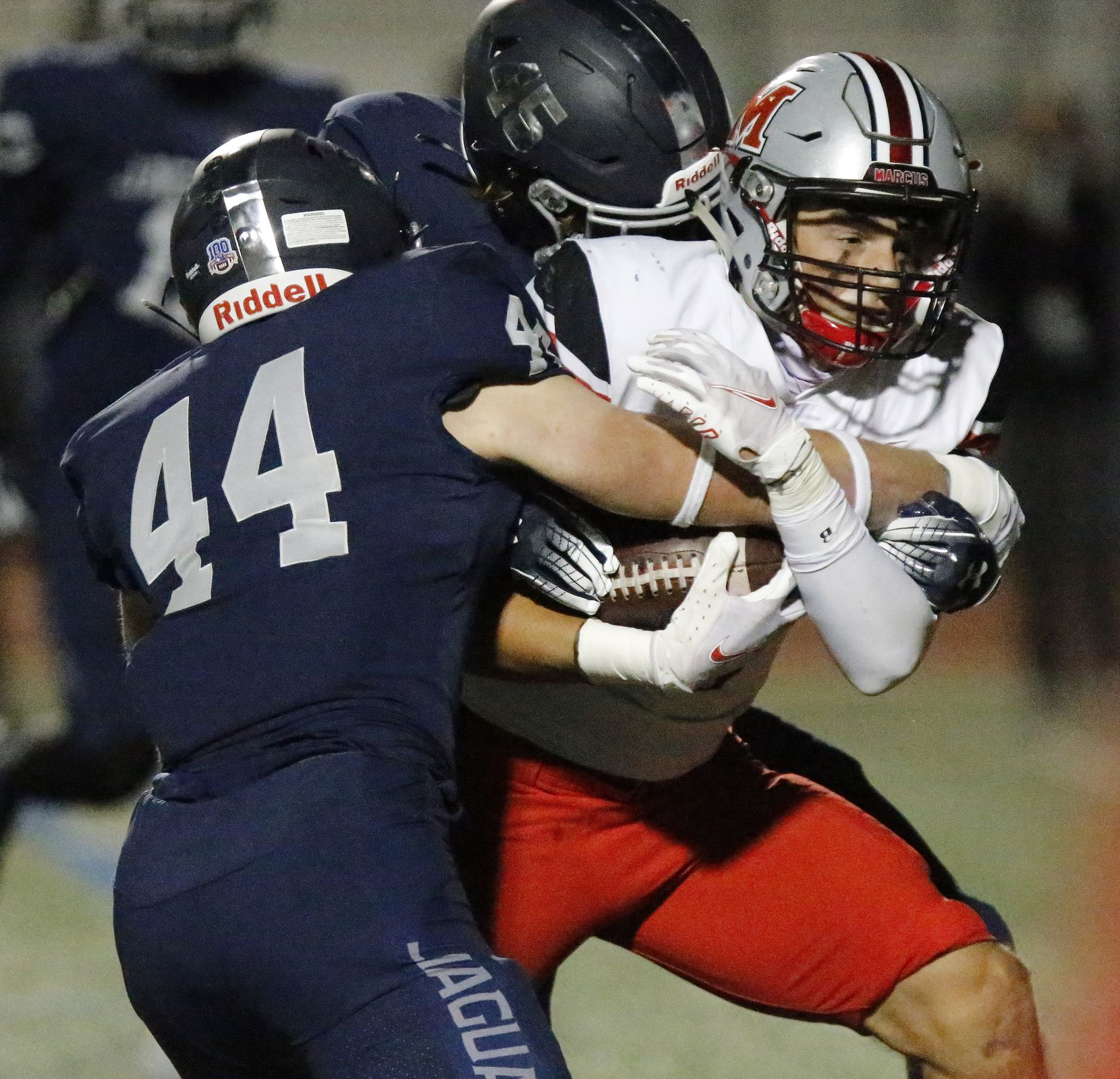 Flower Mound Marcus running back Tyler Schott (3) is tackled by Flower Mound High School linebacker Ryan Brubaker (44) and Flower Mound High School linebacker Joey Lucash (45) during the first half as Flower Mound High School hosted Flower Mound Marcus High School at Neal E. Wilson Jaguar Stadium on Friday night, October 23, 2020. (Stewart F. House/Special Contributor)