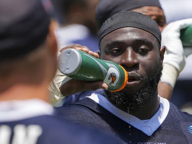 Dallas Cowboys defensive tackle Neville Gallimore (96) gets a drink of water during a practice at training camp on Tuesday, July 27, 2021, in Oxnard, Calif.