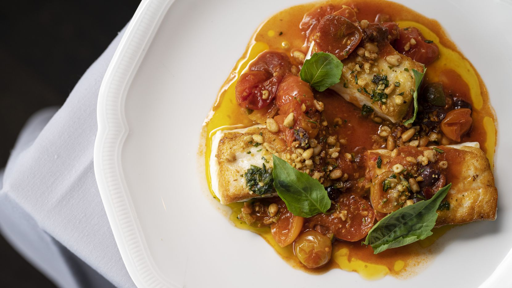 Roasted Halibut with tomato and olive sauce from Chef Eric Dreyer at Monarch restaurant in Downtown Dallas.