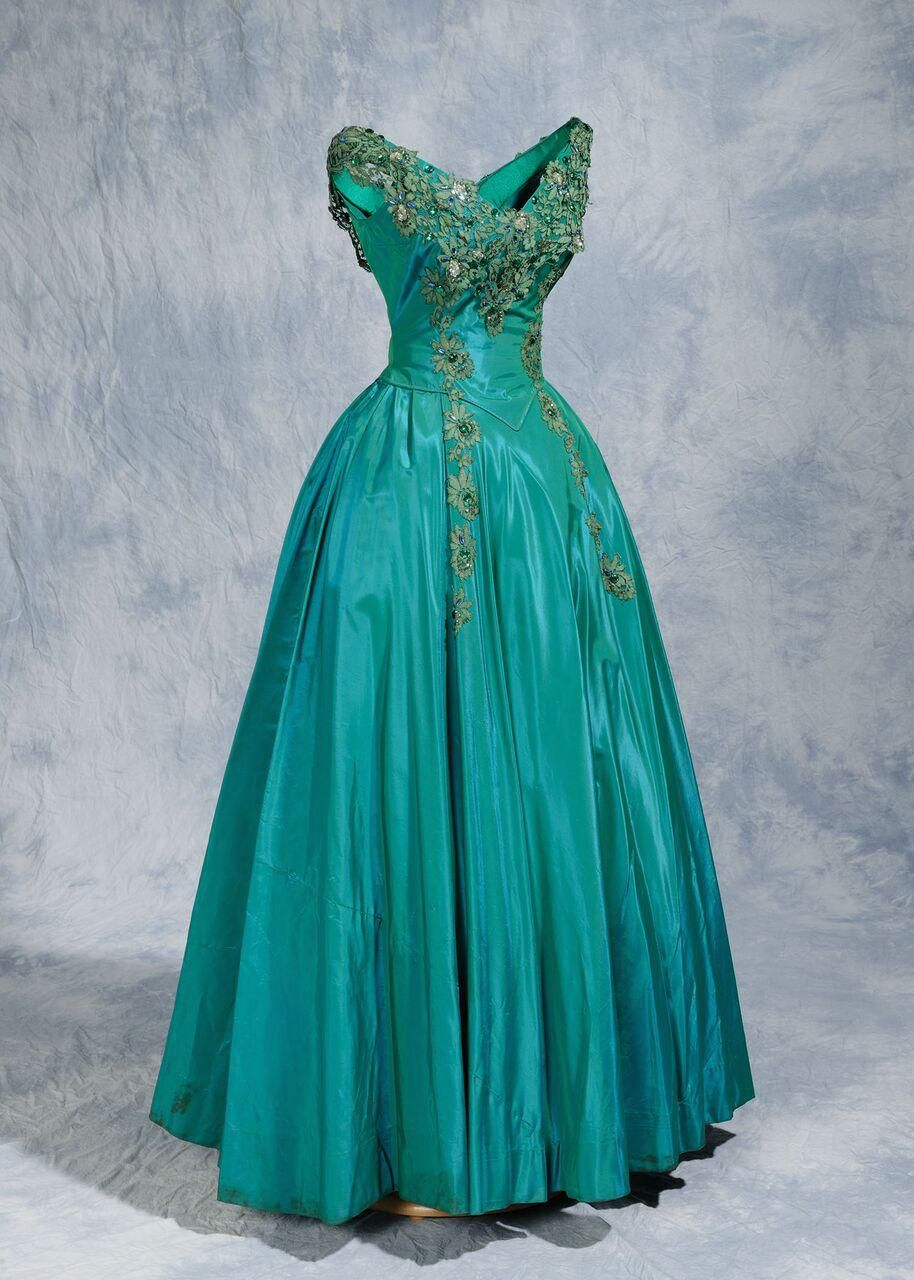 "This satin teal gown embellished with sequins and rhinestones is included in ""Made Especially for You by Willie Kay."""