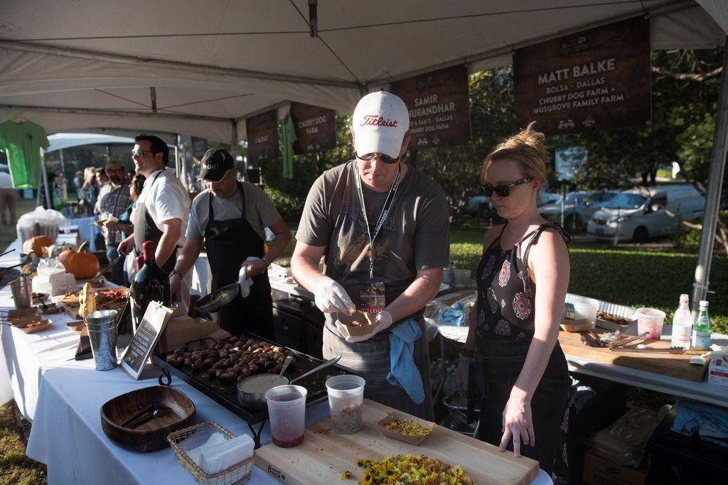 Matt Balke from Bolsa, left, serves smoked pork rillettes during Chefs for Farmers.