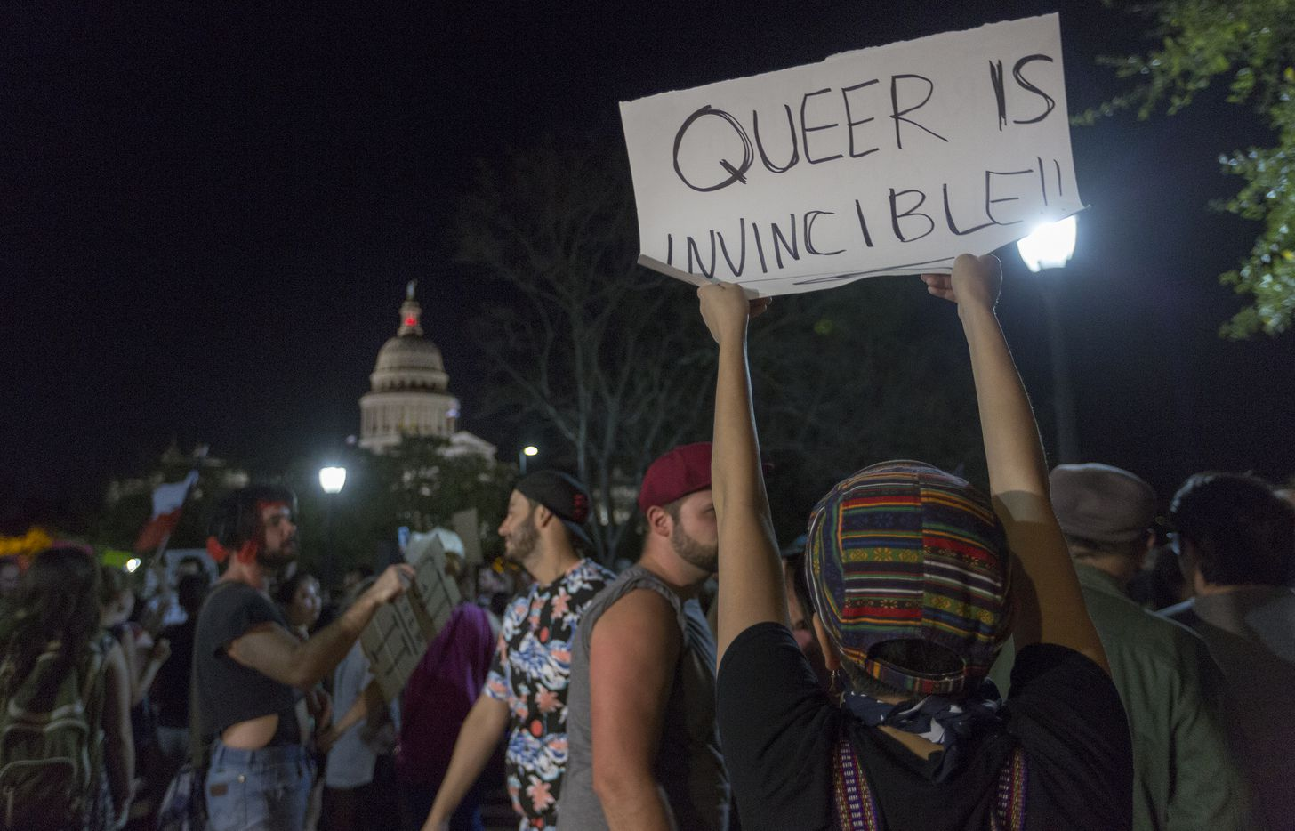 Supporters of the LGBTQ community gather for a dance party outside the Governor's Mansion in Austin, Thursday, Feb. 23, 2017.