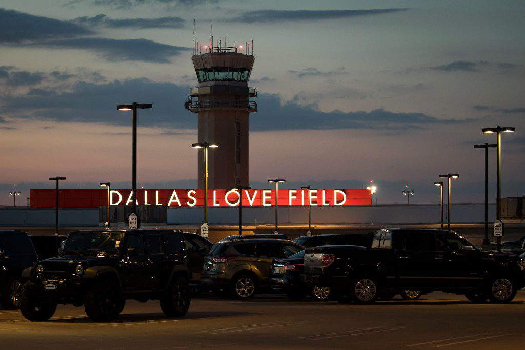 Air traffic control tower and parking lot at Love Field on Wednesday, June 7, 2017, in Dallas. (Smiley N. Pool/The Dallas Morning News)