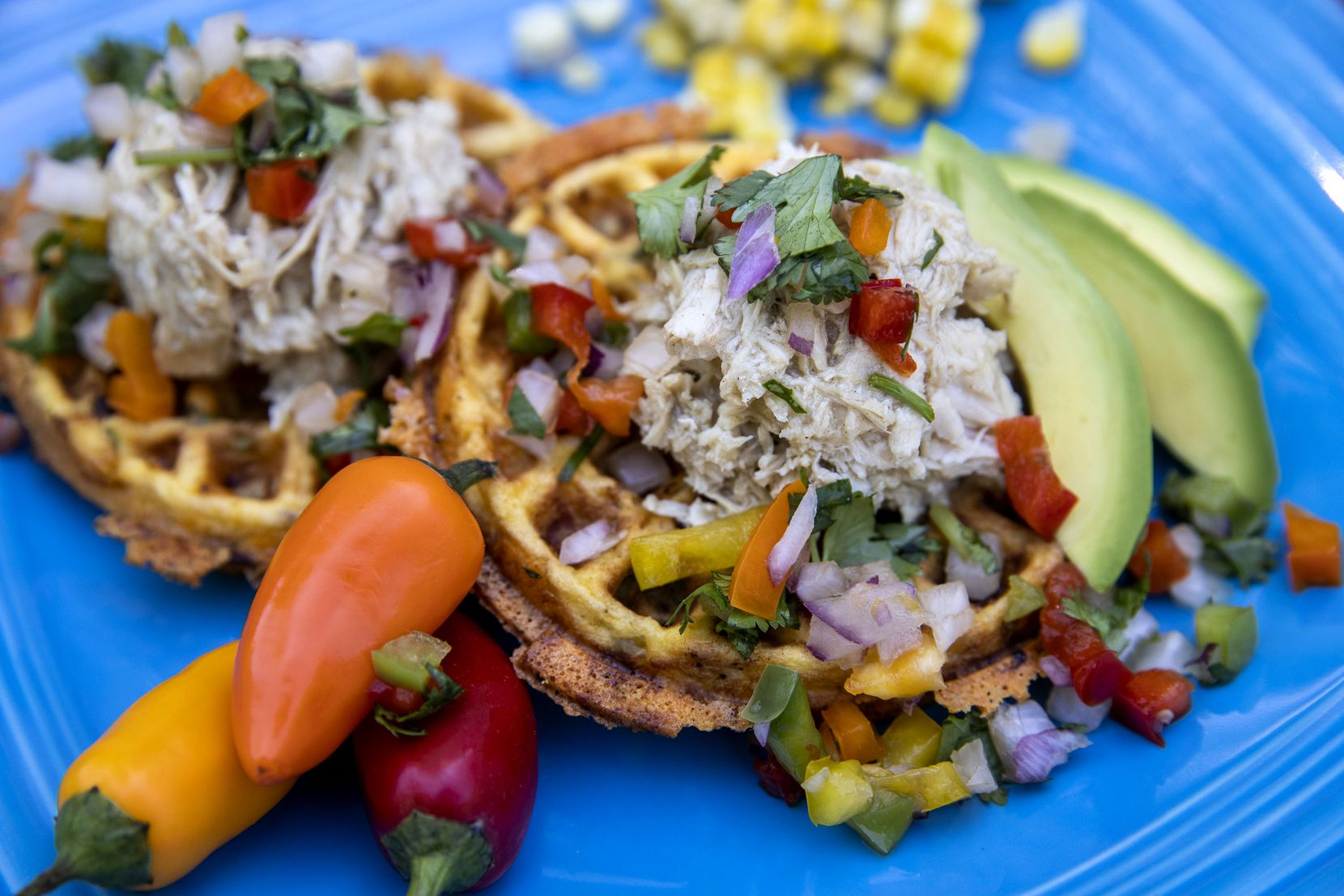 Tex-Mex chaffle is topped with shredded chicken, avocado, mango pico, and cilantro.