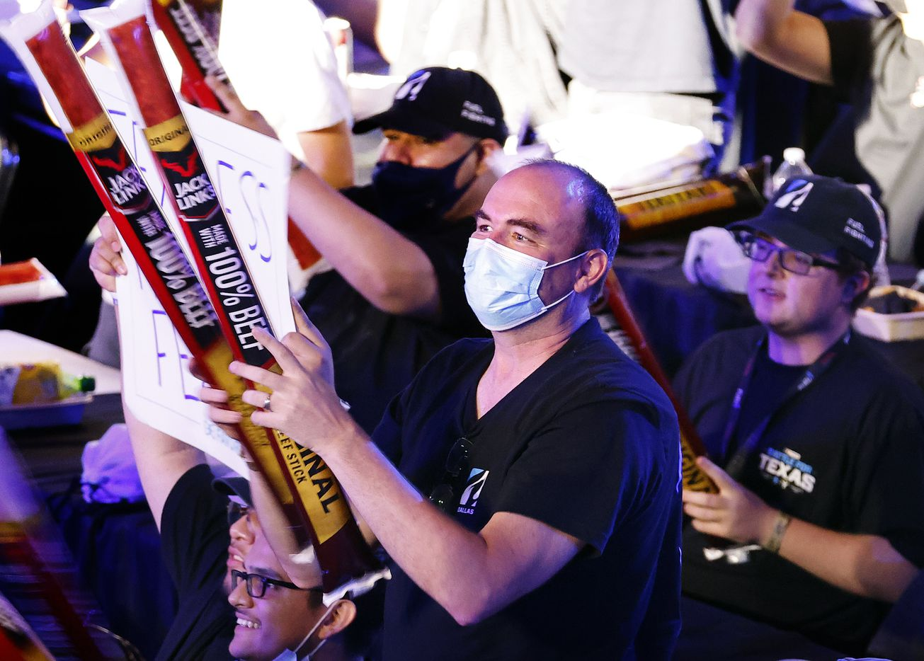 Dallas Fuel fan Collin Corbett (center) slaps his boom sticks as he cheers the team during their Overwatch League match against the Houston Outlaws at Esports Stadium Arlington Friday, July 9, 2021. Dallas Fuel defeated Houston in The Battle for Texas, 3-0. It was the first in-person live competition for fans in over a year. Houston competed from their hometown. (Tom Fox/The Dallas Morning News)
