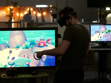 Game designer Alessandro Kitchener demonstrates a VR title called Island Time at Flight School Studios, a video game developer embedded in Reel FX Studios, in Dallas, Friday, March 23, 2018.