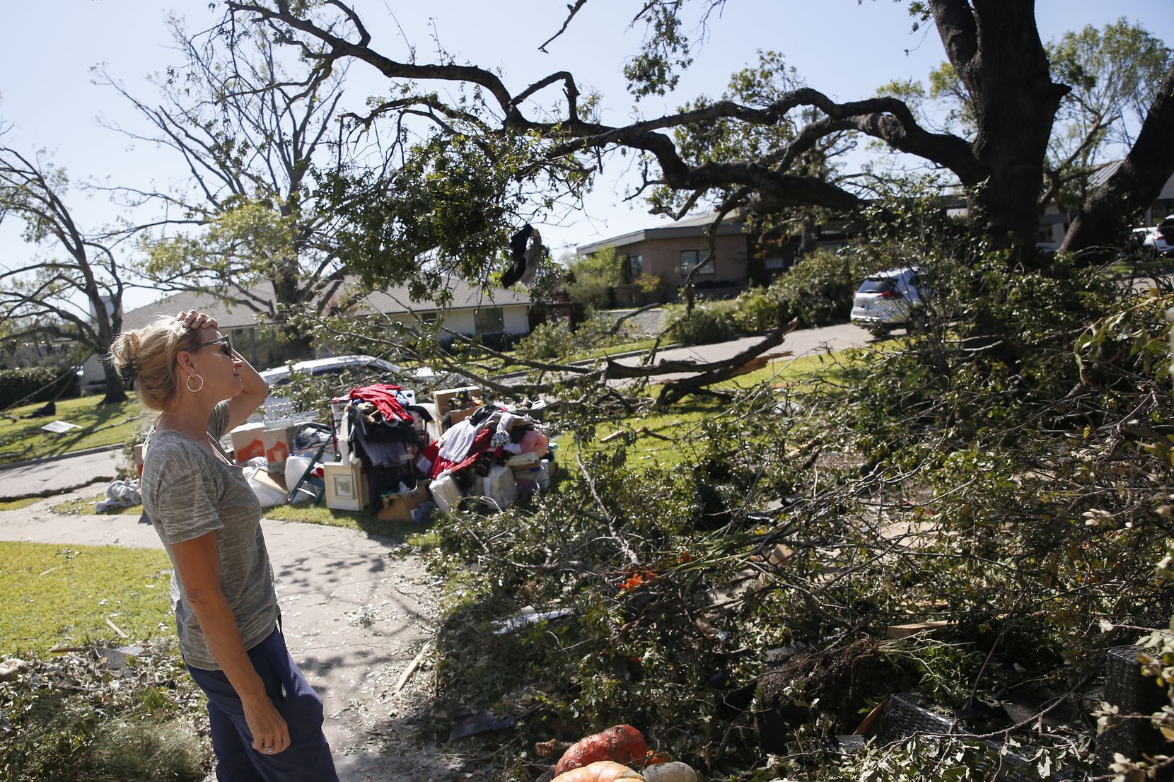 The roof blew off Debbi Bird's home along North Haven Road in Dallas. Bird returned to assess the damage Tuesday.