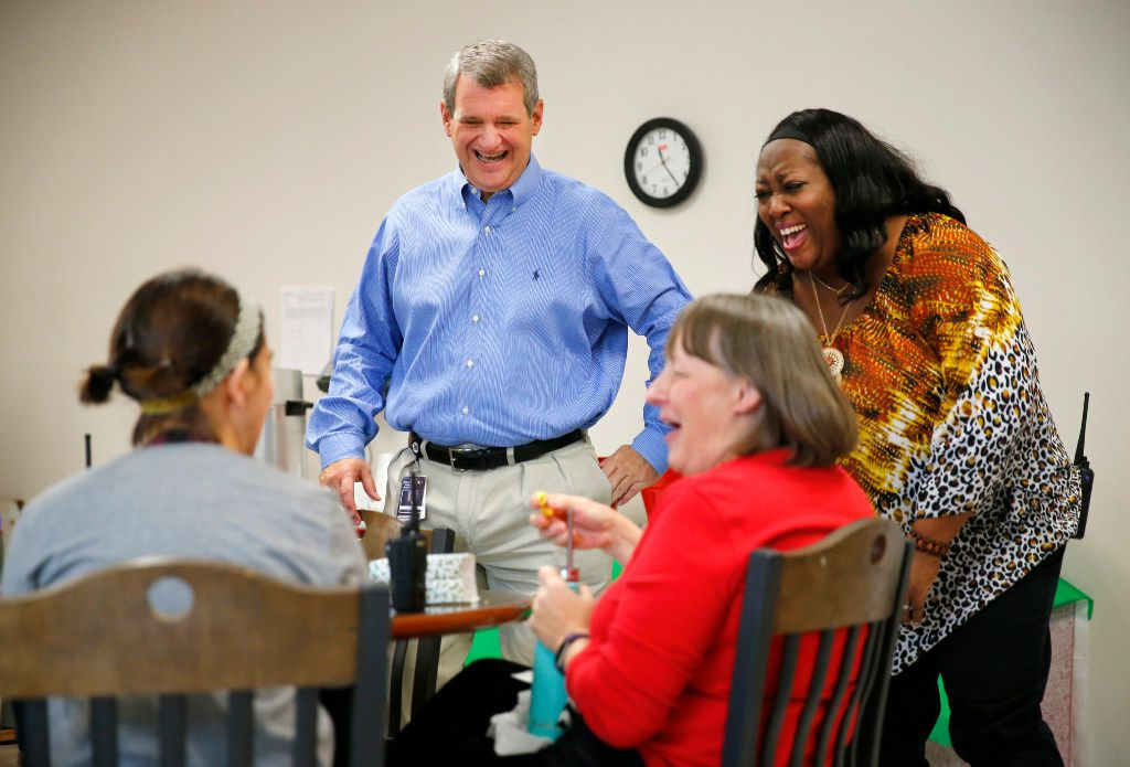 Incoming Allen ISD Superintendent Scott Niven (standing, left) laughs with teachers and principal Shondra Jones (standing, right) at Shields Elementary in Red Oak, , where he is the outgoing superintendent. (Tom Fox/The Dallas Morning News)