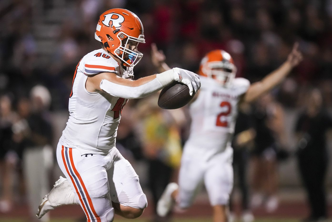 Rockwall tight end Brennan Ray (40) scores on a 21-yard touchdown pass during the second half of a District 10-6A high school football game against Rockwall-Heath at Wilkerson-Sanders Stadium on Friday, Sept. 24, 2021, in Rockwall.  Rockwall-Heath won the game 79-71 in double overtime.