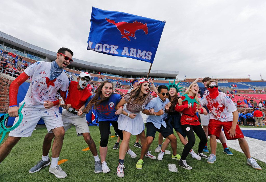 SMU fans get revved up before kickoff during the University of Memphis Tigers vs. the SMU Mustangs NCAA football game at Gerald J. Ford Stadium in Dallas on Saturday, November 5, 2016. (Louis DeLuca/The Dallas Morning News)