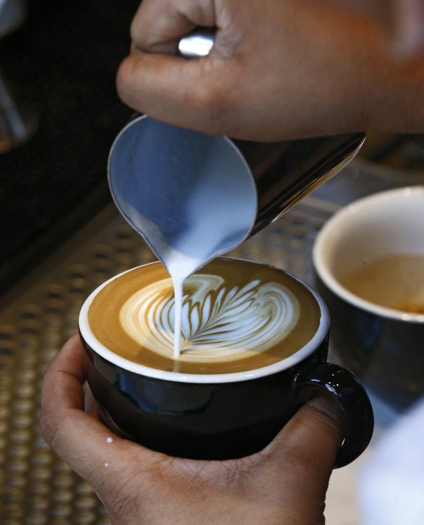 Barista Briana Flores prepares a cappuccino at Ascension Coffee Roasters in Dallas.