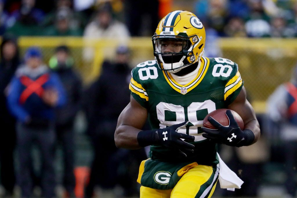 GREEN BAY, WI - JANUARY 8:  Ty Montgomery #88 of the Green Bay Packers runs with the ball in the first quarter during the NFC Wild Card game against the New York Giants at Lambeau Field on January 8, 2017 in Green Bay, Wisconsin.  (Photo by Jonathan Daniel/Getty Images)