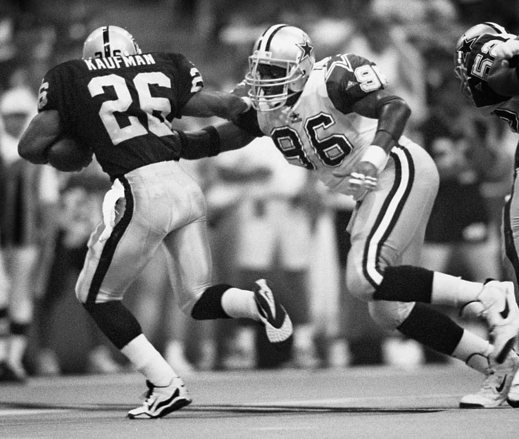8/6/95---Dallas Cowboys defensive end  Shante Carver (96) runs down Oakland Raiders runningback Napoleon  Kaufman (26-left) during a second half action from the teams' pre- season game at Texas Stadium Saturday night.