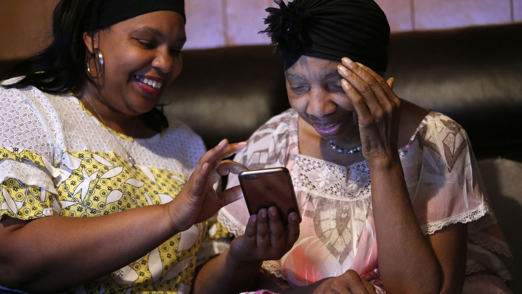 Jennifer Greer (left) plays gospel music for her mother, Carolyn Greer, at their Dallas home. Brain games have slowed her mother's dementia, Jennifer says.