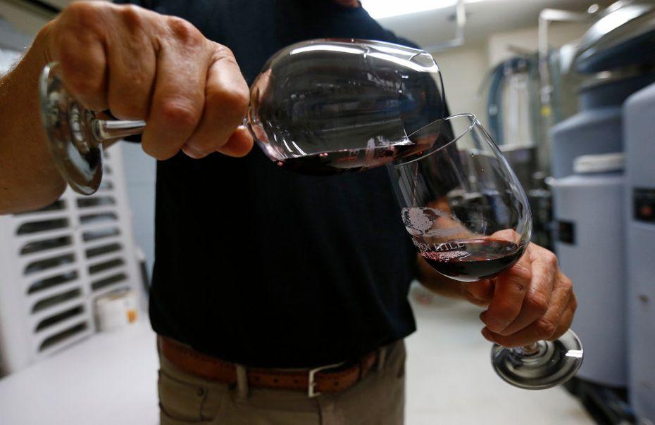 Clark Hornbaker splits a glass of wine at Eden Hill Vineyard & Winery in Celina.