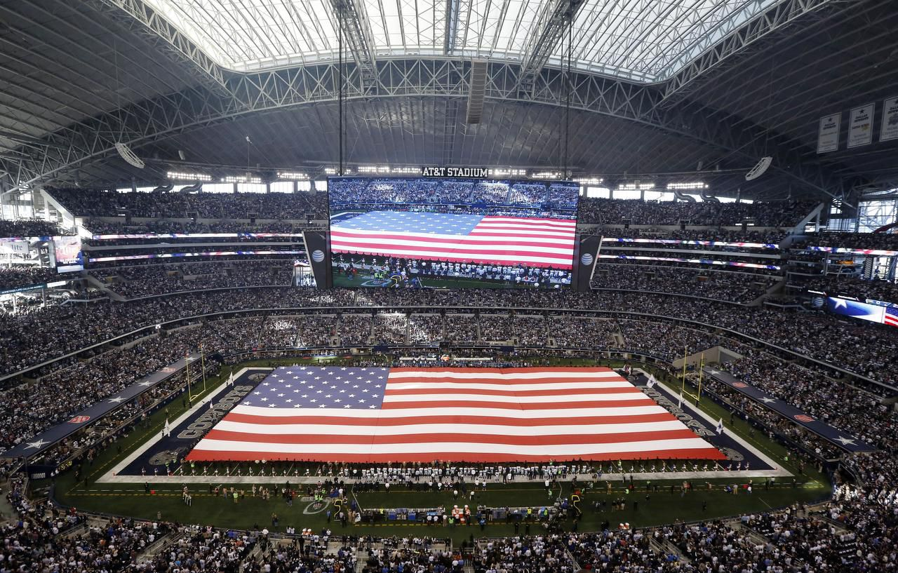 A giant flag was unfurled during the national anthem before a Dallas Cowboys playoff game last January at AT&T Stadium.
