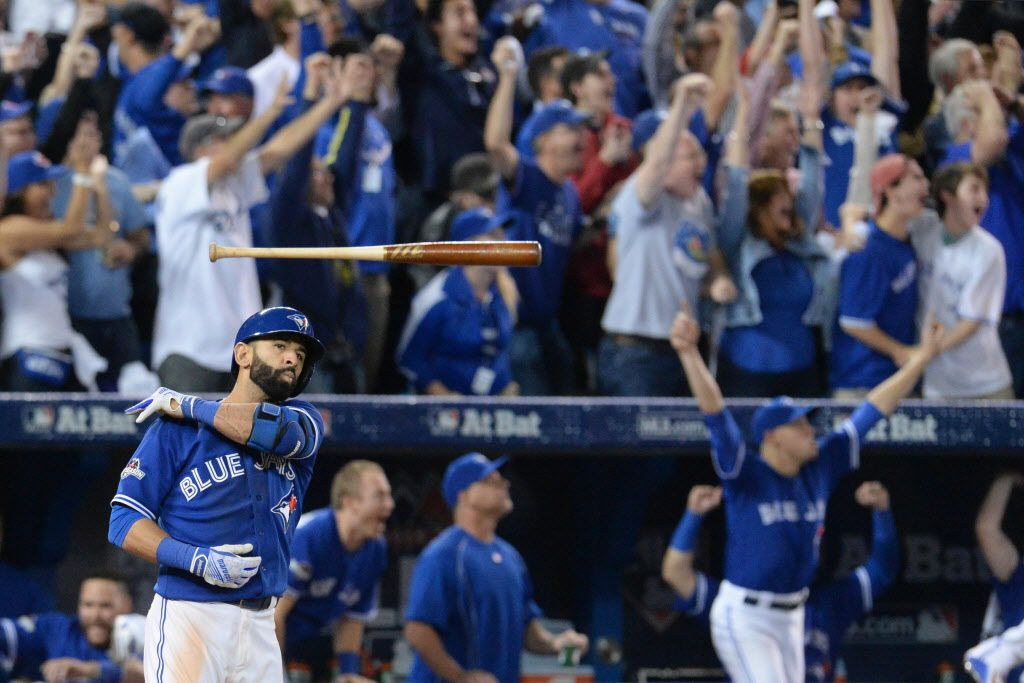Toronto Blue Jays' Jose Bautista tosses his bat after hitting a three-run home run during the seventh inning in Game 5 of baseball's American League Division Series, Wednesday, Oct. 14, 2015 in Toronto. The Toronto Blues Jays beat the Texas Rangers 6-3. (Chris Young/The Canadian Press via AP)