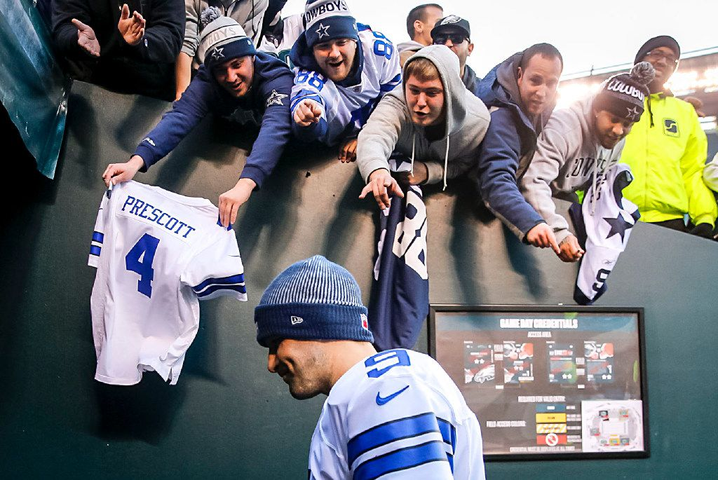 Fans yell to Dallas Cowboys quarterback Tony Romo as he walks off the field after a loss to the Philadelphia Eagles in an NFL football game at Lincoln Financial Field on Sunday, Jan. 1, 2017, in Philadelphia. The Eagles won the game 27-13. (Smiley N. Pool/The Dallas Morning News)