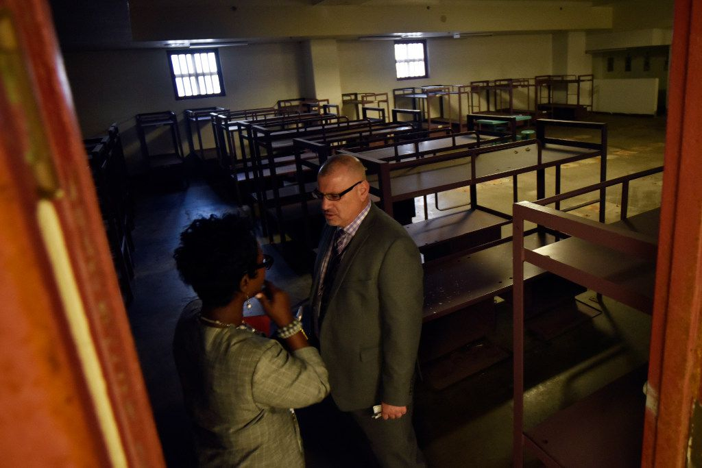 Kim Tolbert, chief of staff for Dallas City Manager T.C. Broadnax, speaks with Majed Al-Ghafry, a new assistant city manager for the city of Dallas, as they tour a sleeping quarters inside the old Jesse R. Dawson State Jail. (Ben Torres/Special Contributor)