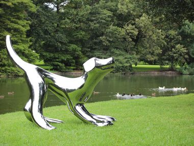 """Dallas artist Brad Oldham's """"Playful Puppy"""" is now on view in Keller."""