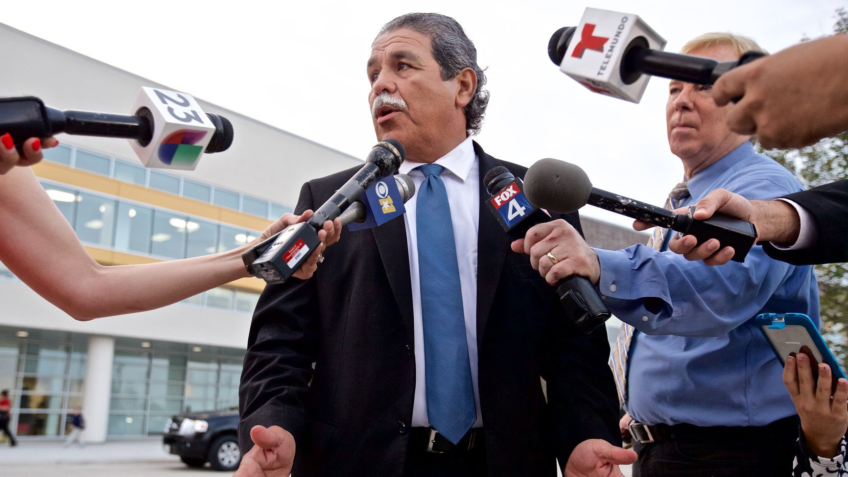 Dallas ISD Superintendent Michael Hinojosa speaks to the media before greeting students on the first day of school.