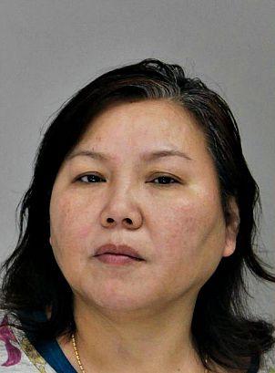 Yong Bei Wang Murphy, known to Dragon House customers as Lucy Murphy, in her mug shot following last week's raids and arrests.