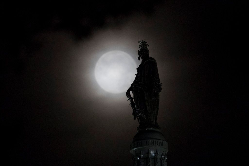 The moon is seen behind the Statue of Freedom atop the Capitol Dome in Washington, July 17, 2019, leading up to the 50th anniversary of the Apollo 11 moon landing.