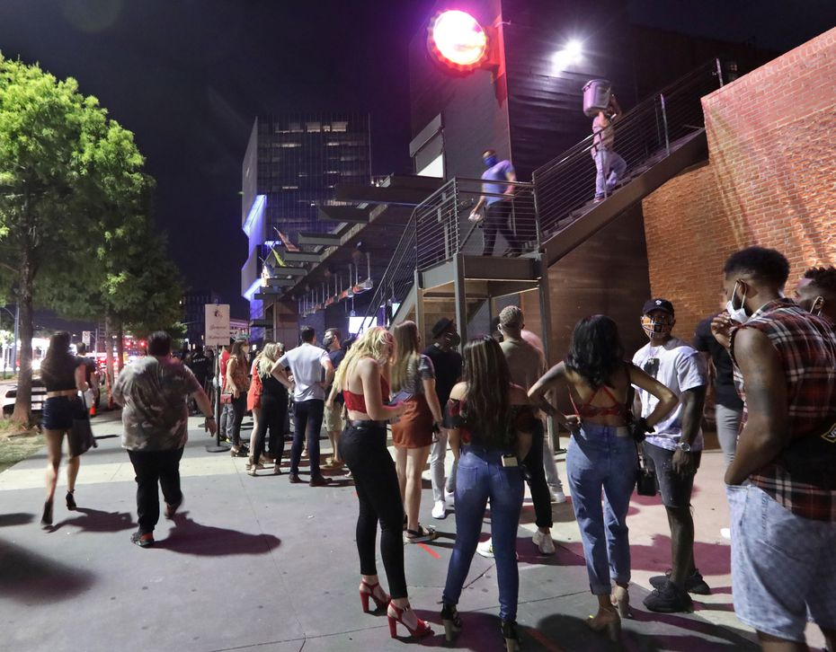 People gather outside Bottled Blonde in Deep Ellum on Aug. 28, 2020, the day it was awarded a food and beverage certificate from TABC.