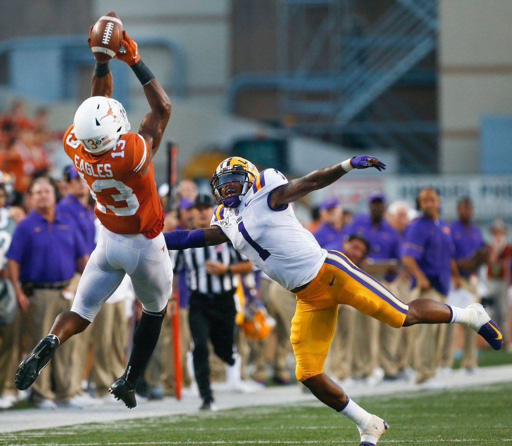 Texas Longhorns wide receiver Brennan Eagles (13) catches a pass over LSU Tigers cornerback Kristian Fulton (1) before running for a touchdown during the second quarter of LSU's 45-38 win over Texas on Saturday, Sept. 7, 2019 at Darrell K Royal Texas-Memorial Stadium in Austin, Texas. (Ryan Michalesko/The Dallas Morning News)