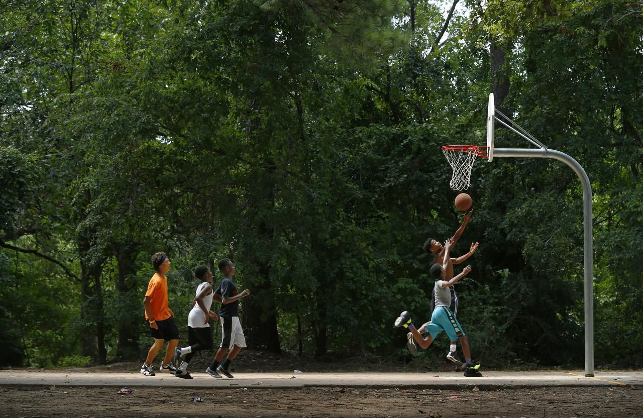 Youngsters play at a park in Joppa — or Joppee, as it's pronounced.  Residents of the Dallas neighborhood push for historical recognition and hope for development.