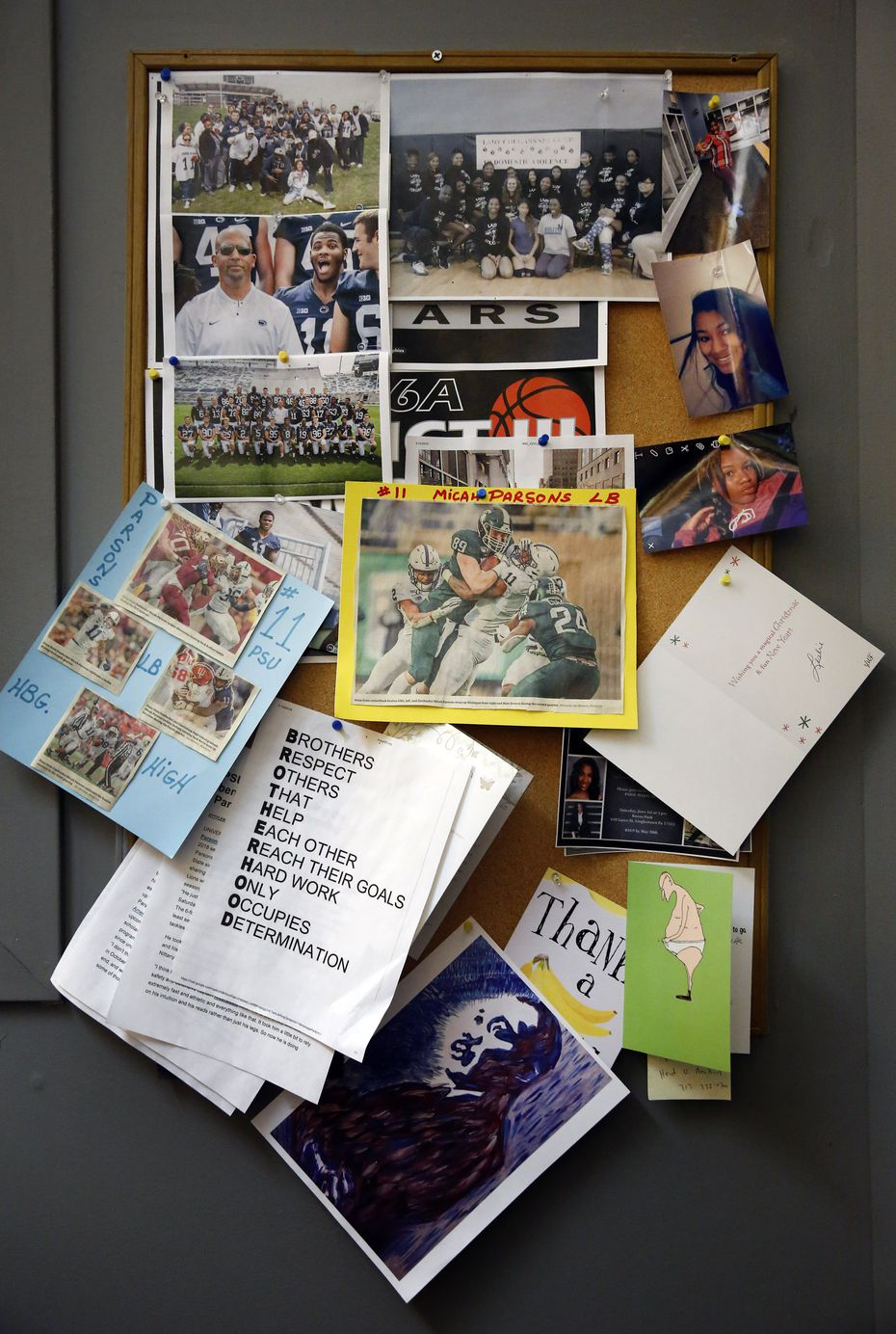 Terrence Parsons, Sr., father of Dallas Cowboys first-round draft pick Micah Parsons, has a collection of football photos of his son on display at Harrisburg High School SciTech Campus in downtown Harrisburg, Pa,, Thursday, May 20, 2021. He works as a security officer there at the school.