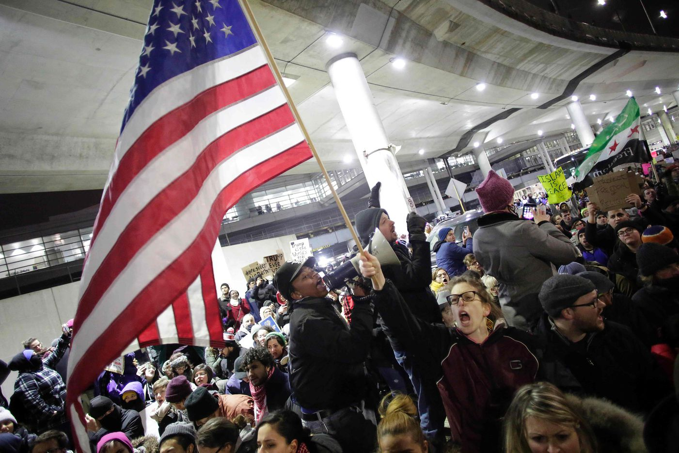 """Demonstrators protest agaist President Trump's executive immigration ban at Chicago O'Hare International Airport on January 28, 2017. US President Donald Trump signed the controversial executive order that halted refugees and residents from predominantly Muslim countries from entering the United States. Trump boasted Saturday that his """"very strict"""" crackdown on Muslim immigration was working """"very nicely."""""""
