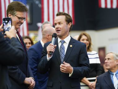 In the session's final two weeks or so, how Lt. Gov. Dan Patrick (left) and Speaker Dade Phelan (center) horse trade will largely decide the fate of staunch conservatives' priority bills on hot-button issues. The two top GOP legislative leaders, shown at 2019 bill signing ceremony in Houston, also must engage with Gov. Greg Abbott (right).