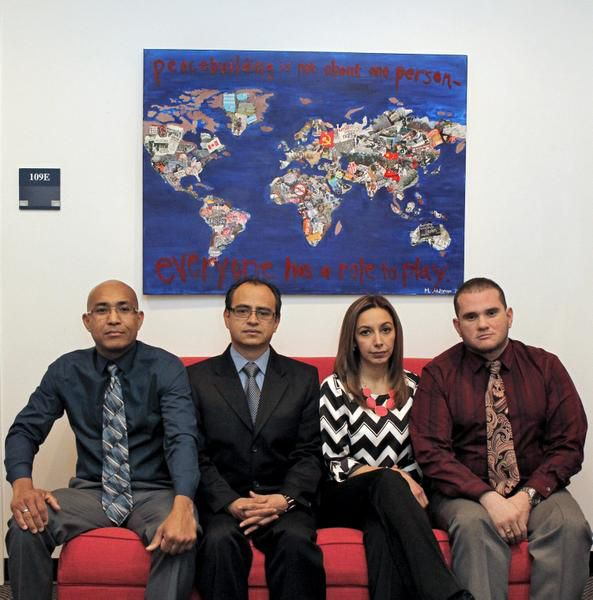 Garland ISD agrees that (from left) Alfonso Casares, Bernardo Montes-Rodriguez, Elizabeth Niño de Rivera and Francisco Marcano have done nothing wrong. But the teachers say that the visa investigation has left them abandoned.