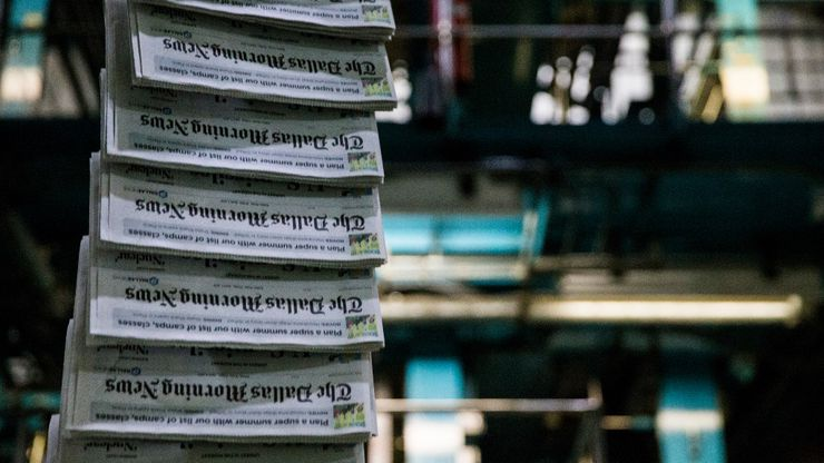 Copies of The Dallas Morning News on the printing presses