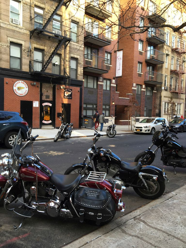 Motorcycles are parked on the street outside the Hells Angels motorcycle club headquarters in New York, Friday, Dec. 16, 2016. (AP Photo/Tom Hays)