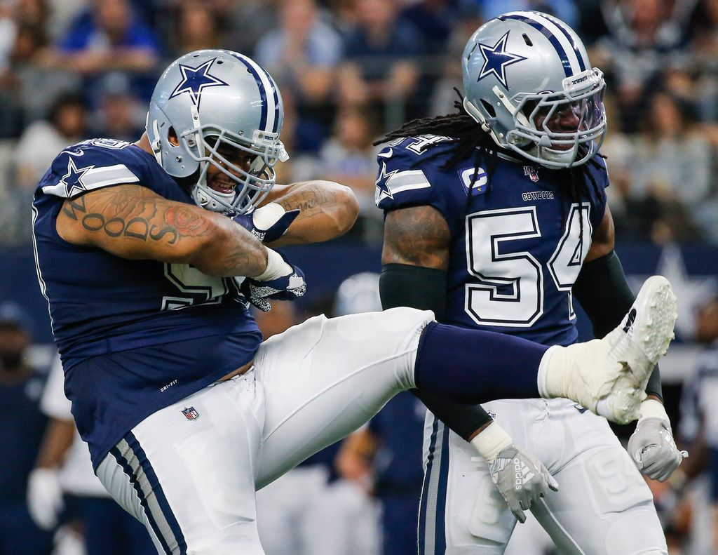 Dallas Cowboys defensive tackle Antwaun Woods (99) and middle linebacker Jaylon Smith (54) celebrate a stop during the first half of an NFL matchup between the Dallas Cowboys and the Los Angeles Rams on Sunday, Dec. 15, 2019 at AT&T Stadium in Arlington, Texas. (Ryan Michalesko/The Dallas Morning News)