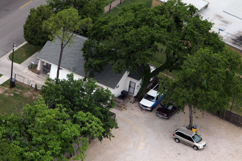 An aerial view of the back yard of the house located at 3116 South Harwood in Dallas, with a large fenced-in gravel parking lot in back, bordering Hwy. 175/SM Wright Freeeway. Dwaine Caraway acknowledged gambling here with his father prior to accusations he chilled a police crackdown