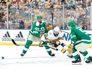 Dallas Stars defenseman Roman Polak (45) battles Nashville Predators right wing Craig Smith (15) for the puck during the second period of the NHL Winter Classic hockey game at the Cotton Bowl in Dallas, Wednesday, January 1, 2020.