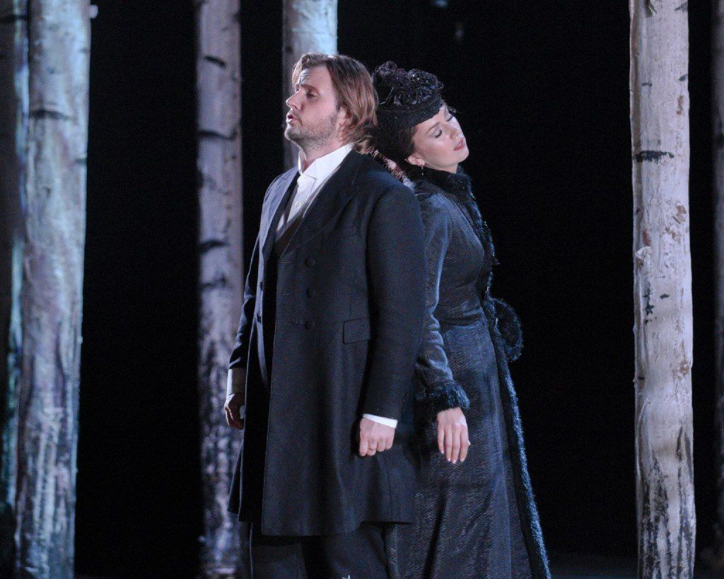 "Love rekindled but denied: Andrei Bondarenko as Eugene Onegin and Svetlana Aksenova as Tatyana, in dress rehearsal for the Dallas Opera's ""Eugene Onegin.""."