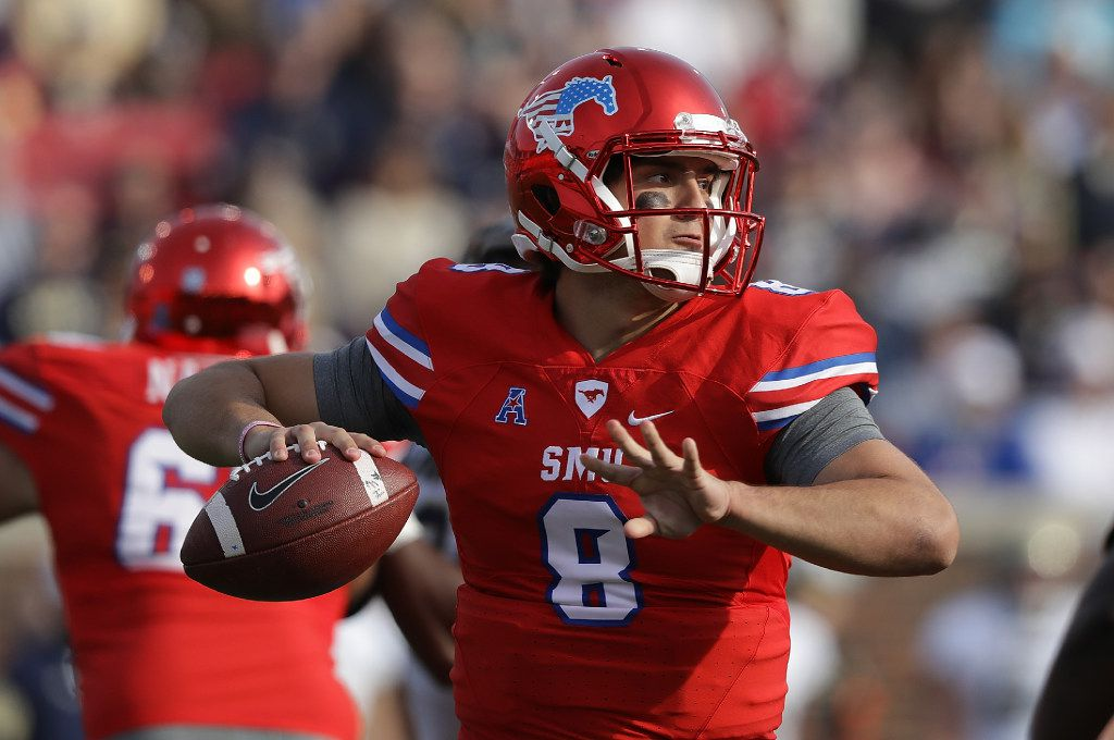 DALLAS, TX - NOVEMBER 26:  Ben Hicks #8 of the Southern Methodist Mustangs throws against the Navy Midshipmen at Gerald J. Ford Stadium on November 26, 2016 in Dallas, Texas.  (Photo by Ronald Martinez/Getty Images)