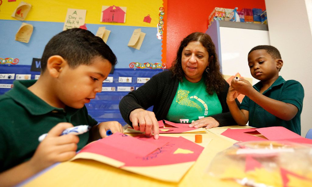 Teacher Felix Avila-Fleming (center) works with her pre-K students Rafael Suazo (left) and Cedric Grant in a classroom at N.W. Harllee Early Childhood Center in Dallas.